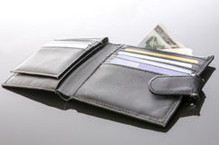 Old open wallet with money and credit cards Stock Image