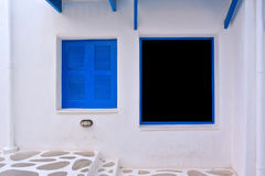The old open window with blue shutters Royalty Free Stock Photography