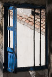 Old Open Window. Remains of a wooden window colored blue window located in a neighborhood of the Realejo (Granada). You can see remnants dela fence that protejia Royalty Free Stock Image