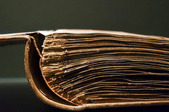 The old opened book on gray background Royalty Free Stock Photography