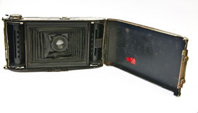 The old opened camera. The old vintage opened camera on a white background Stock Photo