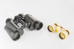 Old opera glass and modern binoculars Stock Photography