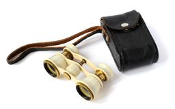 Old opera glasses with a handbag. Old opera glasses with a leather handbag on white background Royalty Free Stock Photography