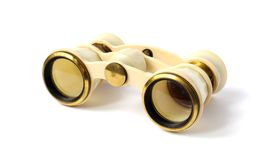 Old opera glasses on white background. Old opera glasses closeup on white background Royalty Free Stock Images