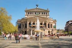 Old Opera House Alte Oper in Frankfurt Germany. Old Opera House Alte Oper in Frankfurt Main in Springtime with Opernplatz fountain and walking people. Frankfurt Stock Photo