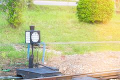Old operated railroad switch and signal  the traffic railway train with sun yellow light.  Stock Photo