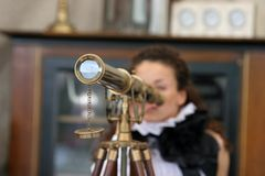 Old optical instrument. Girl looking at old optical instrument Stock Photography