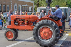 Old Orange Allis-Chalmers tractor in Pella, Iowa. Stock Image