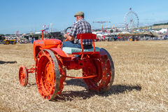Old orange allis chalmers tractor at show Stock Images