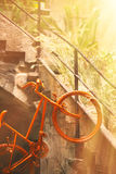 Old orange bicycle Stock Image