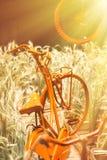 Old orange bicycle Stock Images