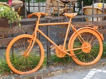 Old orange bike Stock Photo