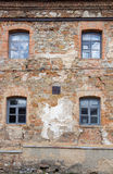 Old orange brick wall with four windows Royalty Free Stock Image