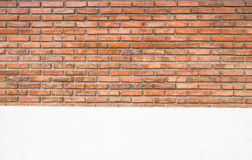 Old orange brick wall and white cement wall texture background Royalty Free Stock Image