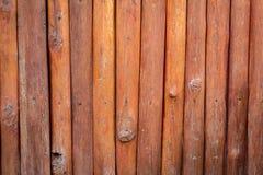 Old orange/brown log wall texture Royalty Free Stock Image