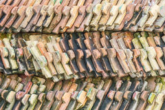 Old orange and brown roof tiles Stock Images