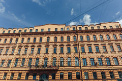 Old orange building facade exterior, old house in St. Petersburg Stock Images