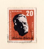 An old orange east german stamp with an image of Hermann Abendroth the famous conductor royalty free stock photography