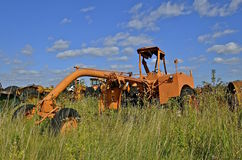 Old orange heavy duty road grader Royalty Free Stock Photography
