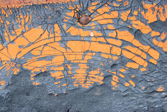 Old orange painted on crack rubber texture Stock Images