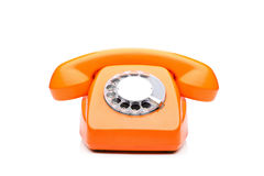 An old orange phone. Isolated on white background stock images