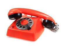 Old orange phone Stock Images