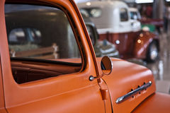 Old orange pickup truck car sideview mirror. Stock Images