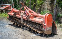 Old orange rotary cultivator Stock Images