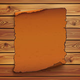 Old, orange scroll on wooden planks Royalty Free Stock Photo