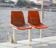 Old orange seat in the boat sailing Royalty Free Stock Photo