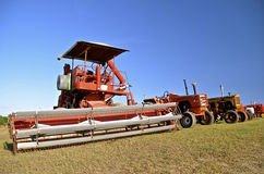 Old orange self propelled combine Royalty Free Stock Photography