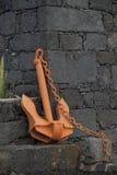Old orange ship anchor