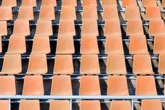 Old orange stadium seats Stock Photography