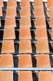 Old orange stadium seats Royalty Free Stock Image