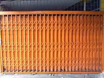 Old orange steel door Stock Images