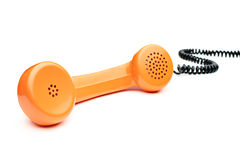 Old orange telephone tube Royalty Free Stock Photo