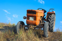 Old orange tractor Royalty Free Stock Photography