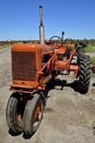 Old orange tractor in a junkyard Stock Images