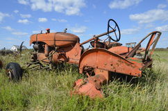 Old orange tractor without rear wheels Royalty Free Stock Photography
