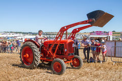 Old orange Tractor at show with loading bucket Stock Images