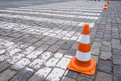Old orange traffic cones at road. Old orange traffic cones at road construction zone Stock Photo