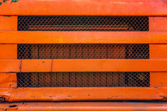 Old orange truck grille. Royalty Free Stock Photography