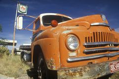 An old orange truck roadside off of Route 66 Arizona Royalty Free Stock Photo