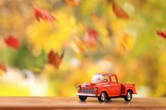 Old Orange Truck Surounded By Falling Leaves Stock Photography