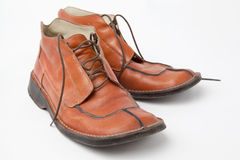 Old orange used men's shoes on white background Royalty Free Stock Photos