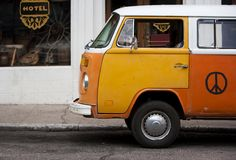 Old orange vehicle in front of hotel Royalty Free Stock Image