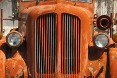 Old Orange Vinatge Fire Truck Sits Rusting in Desert Country Stock Photo