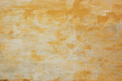 Old orange wall. The texture of an old wall with orange plaster Royalty Free Stock Images
