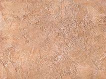 Old Orange Wall Covered With Uneven Plaster. Texture Of Vintage Shabby Sand Brick Surface, Closeup. Stock Photo