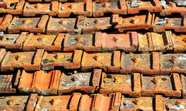 Old orange weathered roof shingles. Dirty stained ceramic tiles Stock Images